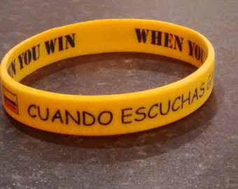 Silicone Wristband: Colombian Proverb/When You talk you lose, When you listen, You win /Yellow, red & blue/Spanish/English/Ideal Party Gift