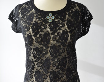 Black lace top embellished with decorative feature at front...stunning!