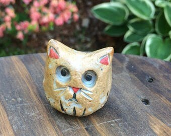 Cute little handmade kitty figurine with red nose