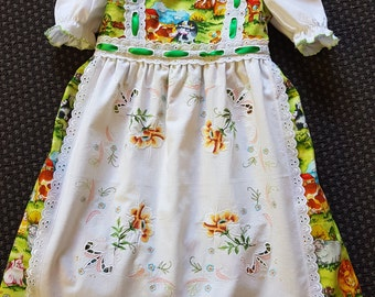 This Girls dress and mock pinafore is simply adorable  size 4