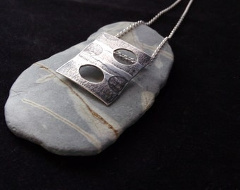 An Oxidised and Textured Pendant handmade in SIlver