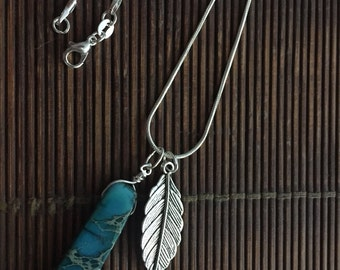 Natural stone charm with sterling silver chain and leaf charm.