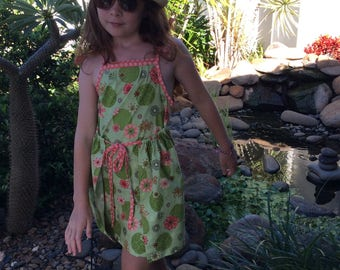 Girls sun dress in green floral with peach spot trim