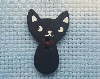 Black cat needle minder