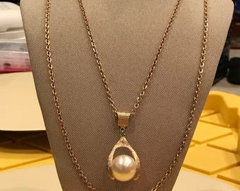 Large faux pearl suspended on gold plated wishbone