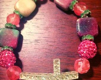 Watermelon colored cross bracelet