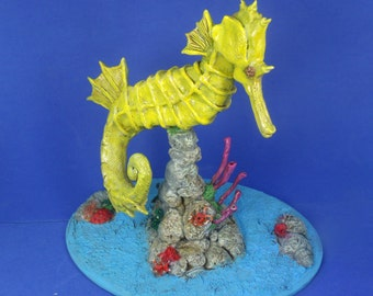 handmade swimming seahorse clay sculpture