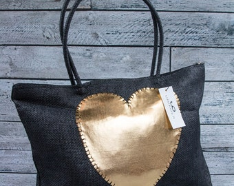 Beautiful lightweight black straw tote with hand stitched heart