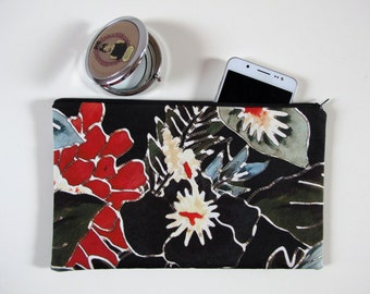 Mini pochette in red and green flower print fabric on a black background, single piece
