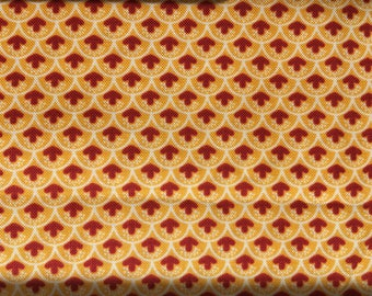 Gold and Red Print Quilting Cotton.  1 and 1/2 yds available.