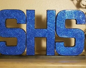 Summit High School Initials coated in glitter