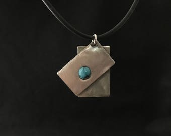 Necklace of silver squares with turquoise cabochon