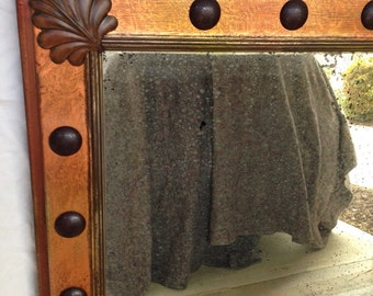 Antiqued mirror with distressed Copper leaf and nail heads