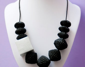 Black card necklace with silver item, handmade, ecofriendly