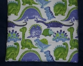 Dinosaurs flannel blanket. Green, Purple and White
