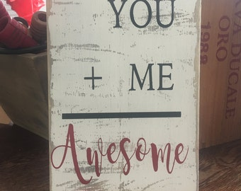 You + Me = Awesome sign