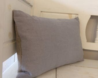 Pale blue linen cushion with raw linen backing.
