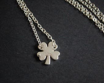 Silver tone four leaf clover necklace
