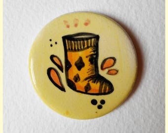 Ceramic quirky brooch of a sock with nice diamond designs on it