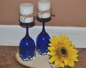 Two blue wine glass candles
