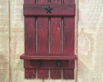 Unique primitive distressed wall shelf with coat hooks