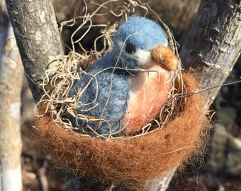 Hand made needle felted bird in a nest
