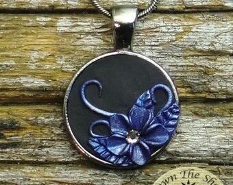 Delicate blue metallic floral design with swarovski crystal pendant