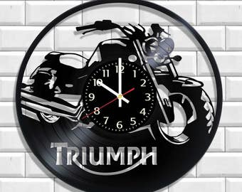 Triumph Wall clock, Triumph poster on the wall