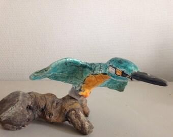 Kingfisher flying light-turquoise