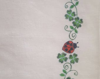 Linen towel with hand painted ladybugs and four-leaf clover