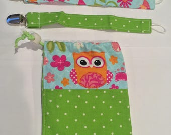 Pacifier clips (set of 2) with matching bag.