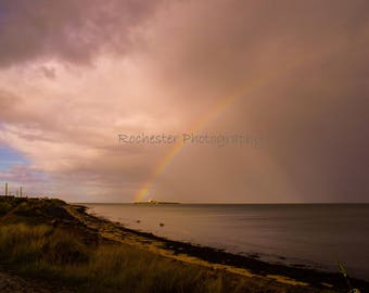 Rainbow over a Stormy Sea