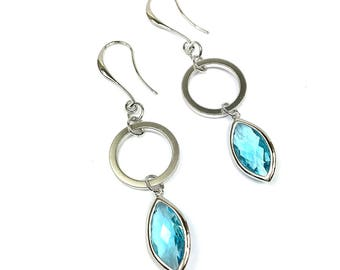 Rhodium earrings with Sky Blue crystals.