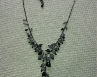 1990's, vintage, black and grey necklace, set in a silver tone.