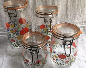 Set of 4 Vintage R. Carman glass canisters