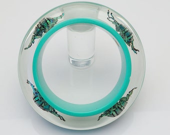 Blue lucite bangle with real iridescent beetles