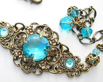 Out of the Mist - Aquamarine Glass Jewel Antiqued Brass Bracelet