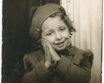 Vintage photo Little Girl Praying in Photo Booth