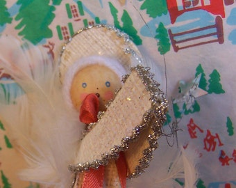 paper and feather angel ornament