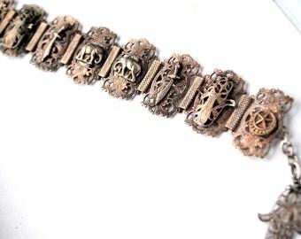 Art nouveau vintage 30s german silver , 8 links, adjustable bracelet with a middle east scane and Fatima Hamsa charm.