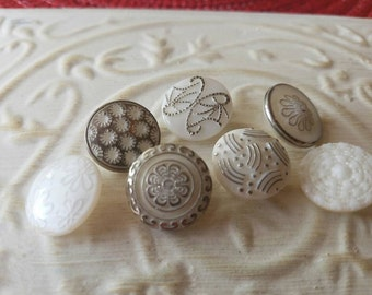 Vintage Buttons - lot of 7 milk glass hand painted medium size pressed glass silver accent  designs.  ( feb 542 17)