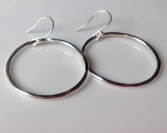 Silver hoop earrings, silver earrings, large hoops.