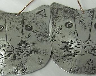 Cat Ornaments. Kitty Ornaments. BUY A KITTY.. Lightweight Silver Tin Cat Face Ornament. Tin Cat Ornament.