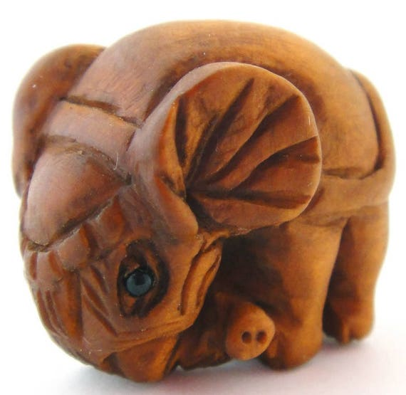 Ojime style hand carved elephant boxwood button from