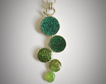 Sterling resin bauble necklace with different shades of green and glitter