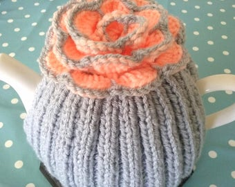 Knitted Teapot Cosy 6-8 cup A Medium Teapot Silver grey with a Peach and grey flower.