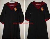 Group listing of two Gryffindor robes, size 4/6 and 6/8, with wands, Harry Potter inspired