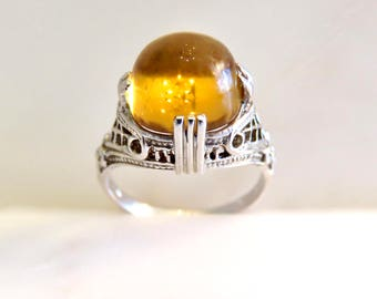 Circa 1930. Cabochon Citrine set in 14KT white gold Art Deco Mounting