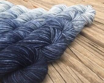 SWM A Perfect Storm Hand Dyed Gradient Sock Yarn Mini Skein Set 475 yards Treasured Toes superwash merino gray silver sky blue dark navy sea