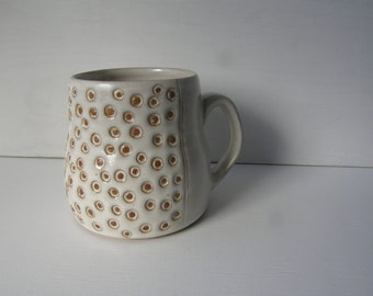 Handmade wheel thrown pottery mug with stamped circles